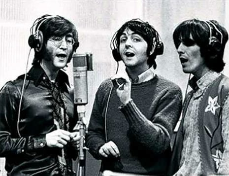 John, Paul and George sing their vocal parts together, into a single microphone.